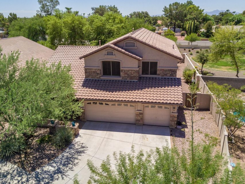 Just Reduced, priced to sell, move in ready! This beautiful highly upgraded home has 4 bedrooms, 3 bathrooms, 3-car garage and 2,636 sf of generous living space. Features vaulted ceilings, new carpets, new fan/lighting fixtures & a cozy family room with gas fireplace. The kitchen has lovely granite countertops, maple cabinets, newer appliances & microwave vented to outside & refrigerator and kitchen island. This is a popular floorplan w/one bedroom downstairs and three bedrooms, large loft & 3 walk-in closets upstairs! Home has gas stubs stove & dryer. Backyard is relaxing with mature trees, large wood-burning fireplace, custom stonework, artificial grass, extended covered patio and more. Home is in a gated community near Marshall Ranch. This is truly a beautiful home, make it yours today!