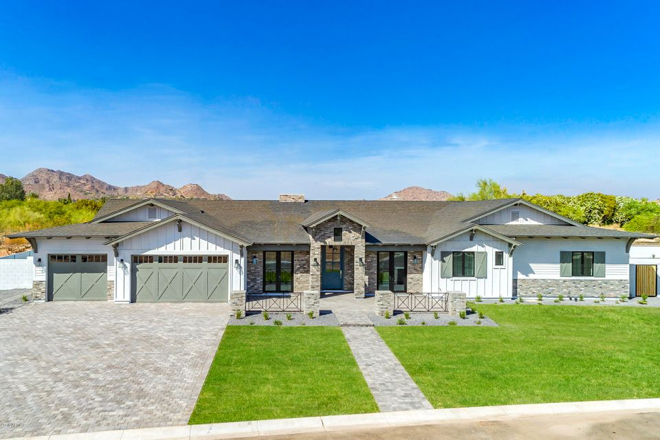 JUST COMPLETED and first time hitting the market. This is the last remaining home in our four home community Estates on Orange. These exclusive cul-de-sac lots are 18,000-20,000 sq ft. The homes in this community feature craftsman ranch design while capturing the functionality and livability today's family desire. This model home is the PERFECT floor plan with finishes unmatched in this price point. Situated in our private cul-de-sac and located in one of the most desirable locations in all of Phoenix.  This will one will go quickly!