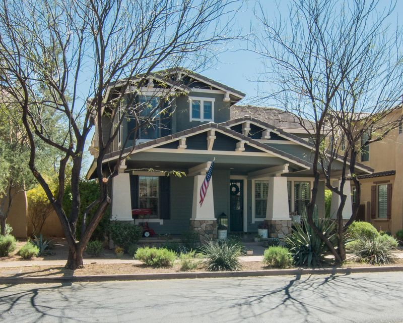 Great opportunity to live in one of the most desirable locations in North Scottsdale, DC Ranch! Conveniently located to all of the best amenities N. Scottsdale has to offer, including AJ's, DC Ranch Village Health Club and Spa, shopping, dining and the McDowell Sonoran Preserve Gateway Trail. This Craftsman style home is located directly across the street from a large grassy park and play area. You will fall in love with the soaring ceilings and dramatic staircase upon entry. This 5 bedroom, 3.5 bathroom home has been meticulously cared for and recently upgraded. New wood-look ceramic tile and carpet throughout. Lower level includes office, powder room, living room, dining room and guest ensuite with separate entrance. Home is equipped with dimming light switches, keyless entry, pre-wired speakers and EcobeeThermostat. The open and bright kitchen has a large island, granite slab counters with back splash, stainless steel appliances including a 6 burner gas stove and dual ovens. Kitchen opens up to a large family room with beautiful brick accent wall with fireplace and entertainment niches. Upstairs includes a spacious master suite, 3 bedrooms and a full bathroom. The master bathroom has been completely remodeled to include a dual vanity, custom California walk-in closet and huge tiled walk-in shower with 3 shower heads, including 1 waterfall style. Enjoy the grassy park across the street or entertain in your own backyard that includes spa and built in BBQ. This home has it all!!