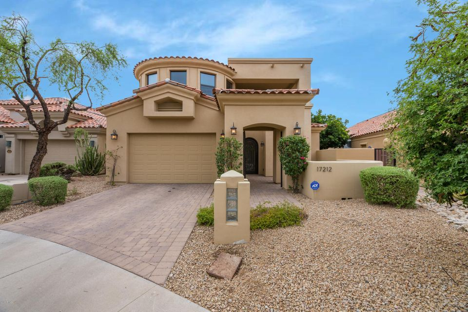 Great opportunity to own a fabulous home in the stunning gated community of Alcazar!! This beautiful semi-custom home is one of 38 luxury properties nestled across the street from the Fairmont Princess. Alcazar is conveniently located minutes from Kierland Commons, Scottsdale Quarter, West World, which hosts events including Barrett Jackson & the Arabian Horse Show, Mayo & Honor Health, Scottsdale Airport, 101 Freeway and more. Situated on a peaceful cul-de-sac, you enter through your gated courtyard and are greeted by a lovely wrought iron front door. Once inside you can't help but fall in love with the bright home that boasts 2 story vaulted ceilings with upper windows allowing cascades of light through!! Ideally located on the main floor is one of the 2 spacious master suites with an elegant private bathroom offering a large vanity with double sinks and abundant storage. Take a nice long soak in your deep, free standing bathtub or there's lots of space in your large, walk-in shower. The finishes give this bathroom a relaxing spa-like feel. The dreamy kitchen sits under beautifully exposed wood beams and opens up to the living room and a formal dining room.  A deep farmhouse sink sits in the massive center island that also houses a microwave oven drawer. Impressive stainless steel Monogram appliances include a 5 burner gas stove with luxury range hood, over-sized refrigerator and double wall ovens. Make your way up the beautiful wrought iron staircase where you'll find a large open loft area perfect for a media room or office space and a guest bathroom. Continue on to the over-sized guest bedroom with balcony access and it's own walk-in closet. One of the best features of this home is the second master suite upstairs. Its  bathroom has a walk-in closet, dual vanities, soaking tub and large walk-in shower. This room has its own private balcony that over looks the backyard and mature trees. The backyard has maintenance free landscaping, an abundance of greenery, covered patio and space for entertaining. This house gives you every reason to want to turn it into your next home!!!  <h2>View the 3D Interactive Tour!</h2> <iframe width='853' height='480' src='https://my.matterport.com/show/?m=f43uL83msub' frameborder='0' allowfullscreen allow='vr'></iframe>