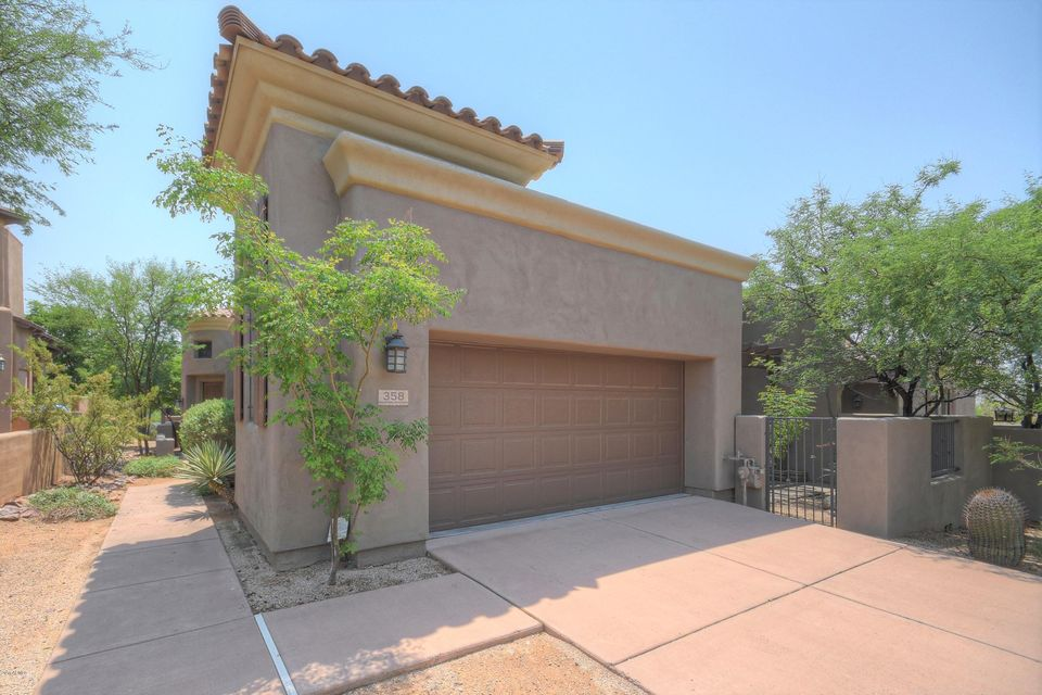Welcome to 9270 E Thompson Peak Pkwy, #358! Enter the home into a quaint foyer which opens into the spacious family room featuring a beautiful floor to ceiling stacked stone fireplace. Off the family room is access to the covered patio with walls for added privacy. The family room opens into your formal dining area then to the eat-in kitchen. The kitchen includes an island, gas cook top, pantry and additional sliding glass doors for easy access to the backyard and built in BBQ. Making your way down the hall, you'll first notice the large office space or media room. To the left is a half bath and down to the right is the 2nd bedroom with a walk in closet and own full bath. The high ceiling master suite brings in plenty of natural lighting from the sliding doors that take you out to the front patio. The master bath includes dual vanities, separate tub and shower, and walk-in closet. Schedule your showing today!