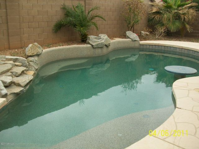 Beautiful pool with water feature.