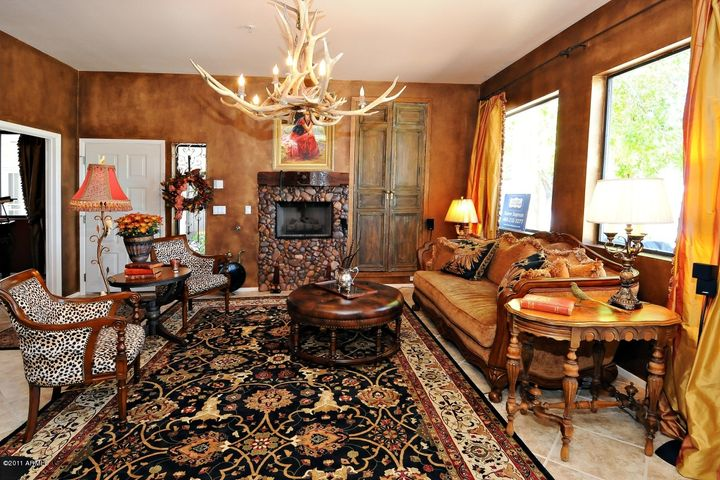 Dramatic Stacked Stone Fireplace & Ornate Carved Wood Mantle