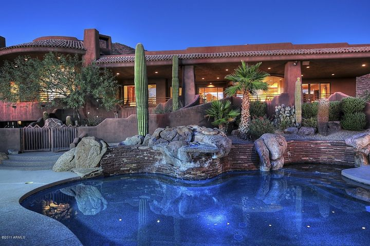 Resort-like backyard including Pebble-Tech Pool and Spa with Boulder Water Feature, Fire Pit, Tennis/sport court - all with beautiful Mountain and City Light Views!!