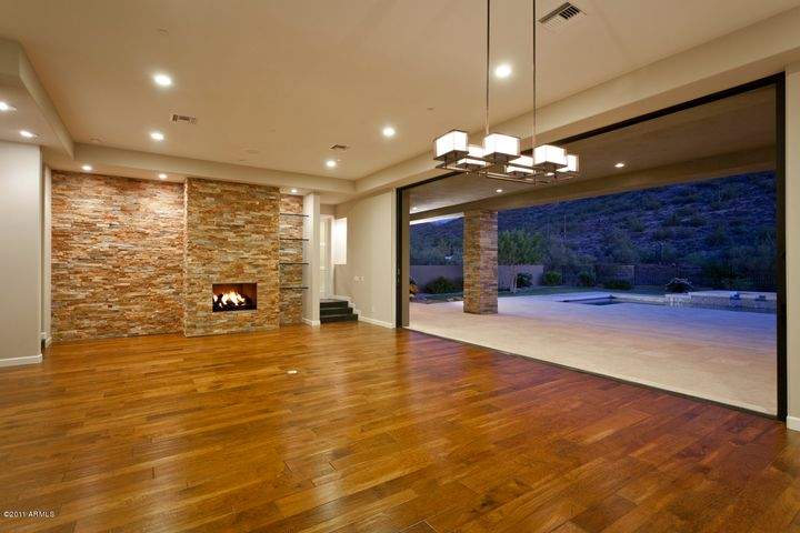Great room has' Stacked Stone' Fireplace with 1' Glass Shelving