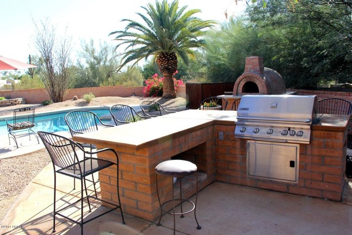 Pool, BBQ island for entertaining and pizza oven.