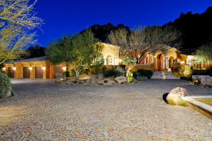 Rarely seen Granite stone driveway hand laid in scalloped design graces the Motor Court and front entry courtyard, guest parking and 4 car garage entry. Stone capped walls guide guests toward Entry Portico and Terraces where fountains and sun drenched patios wrap the front of the home.