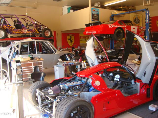 Evap cooled 12 car garage + 10 additional cars with lifts.