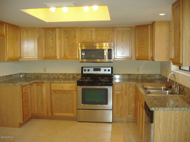 NEW CABINETS, GRANITE COUNTERTOPS, STAINLESS STEEL APPLIANCES, SINK, FAUCET AND LIGHT FIXTURES!