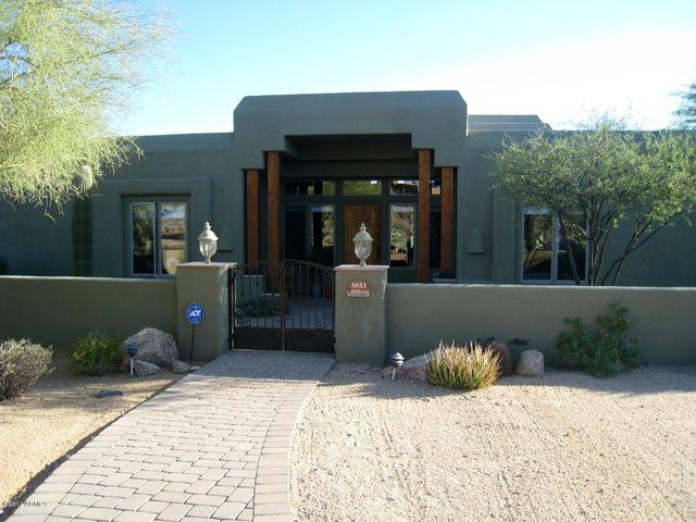Front Entry leads to lovely gated courtyard.