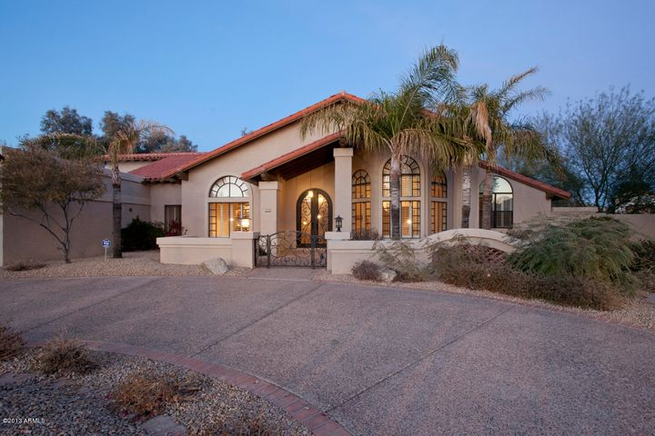 Welcome to 9867 N. 107th Street in the private , gated neighborhood of The Estates at Scottsdale Ranch. This 4,300+ sq ft cul de sac home on 3/4 acre mountainview lot has 6 bedrooms and 7 baths.