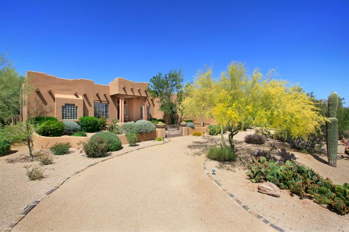 This large custom home also features a side entrance, spacious 3-car garage.