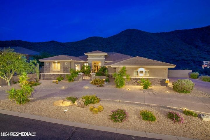 Beautifully landscaped front yard, circular drive way, with side loading garages.