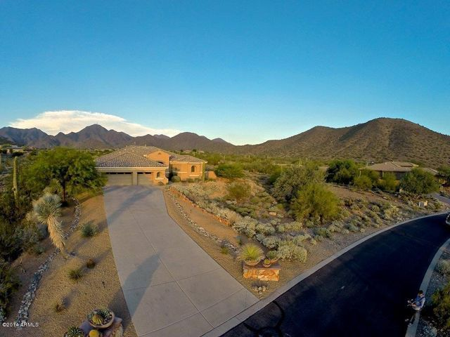 Your new home is tucked away and surround by McDowell Mountain Views.