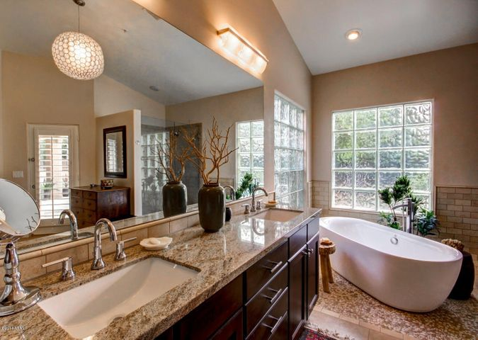 Dual Sinks and a freestanding tub. Ample natural light.