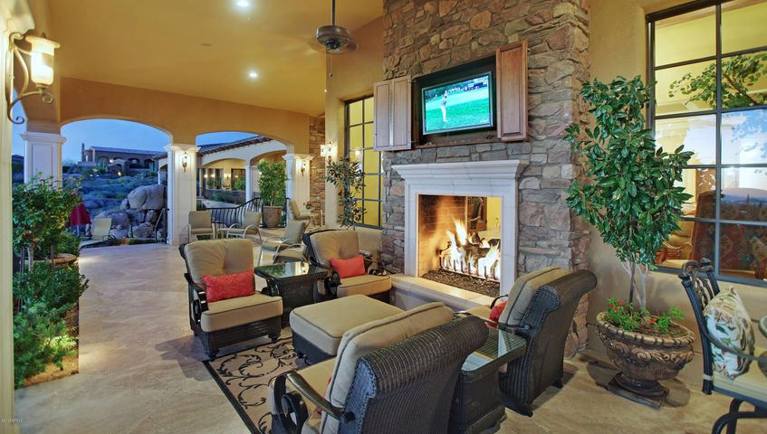 A dream residence in the gated community of Talus begins with an exquisite setting overlooking the 3rd green of Monument Golf Course and offers unparalleled views of mountains and city lights from the inside to out.