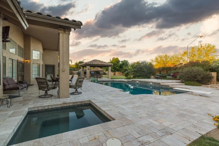Fully paved patio, heated spa and pool