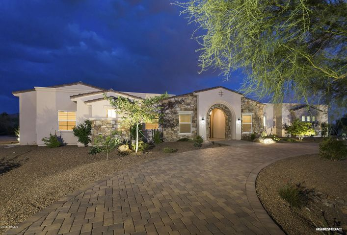 Front of home with circular paver drive