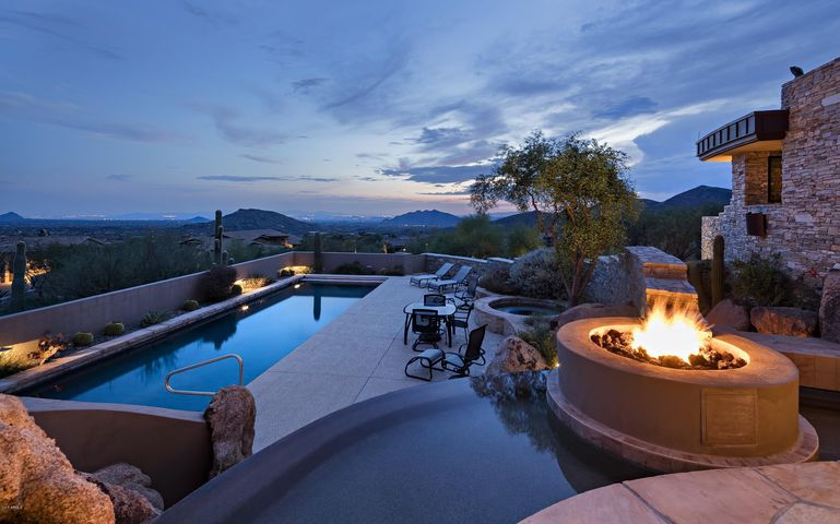 Inviting evening sunset with water features and fire pit to sit and enjoy the valley views