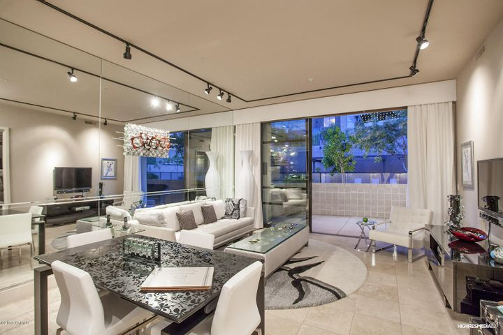 Sliding Wall of Glass opens to Expansive Courtyard!!
