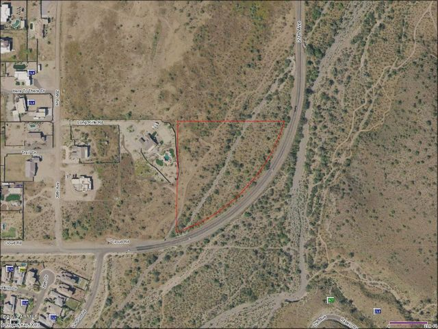 Check out the lush wash that borders this lovely 5.63 Acre lot!