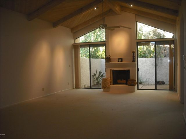 View of Wooden Vaulted Ceilings in Huge Living and Dining Area