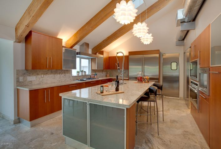 A kitchen for serious cooking with top-notch appliances & rich Italian cabinetry. Lit & vented with a skylight.