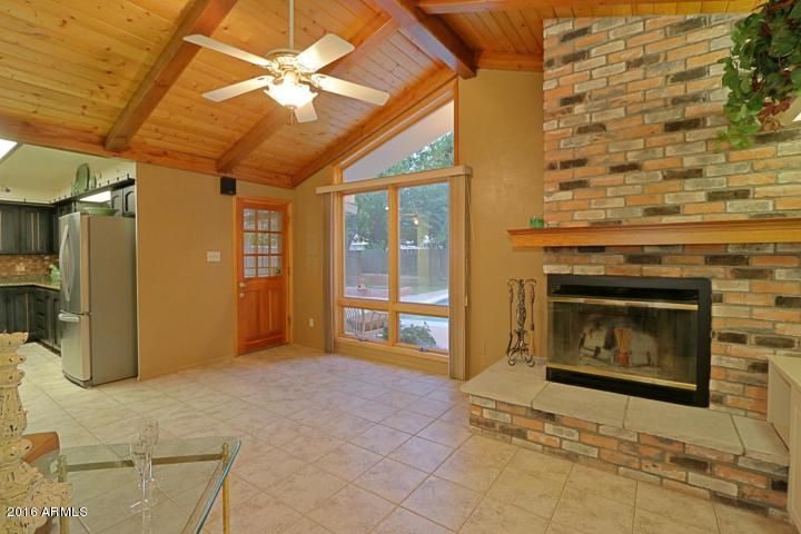 Fantastic family room leads to back yard & covered patio. Wonderful cozy fireplace
