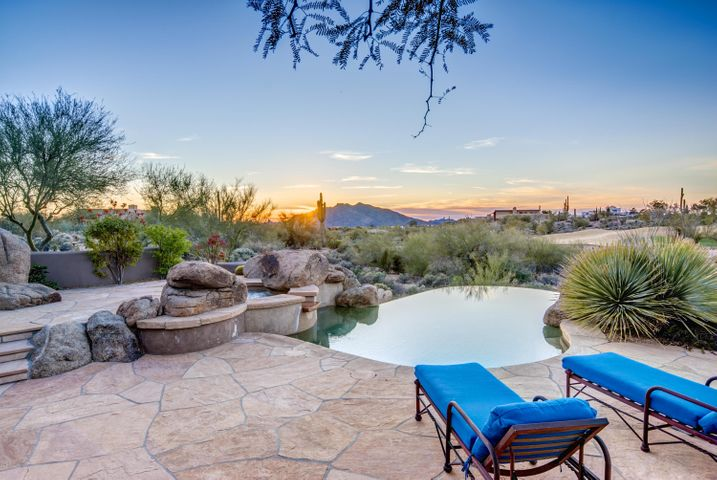 Relax by this negative edge pool and enjoy the views of Black Mountain.
