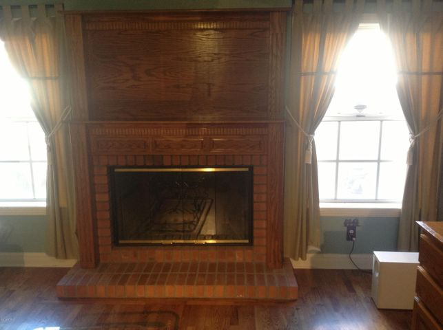 IS THAT OAK, NO IT'S A RED BRICK FIREPLACE