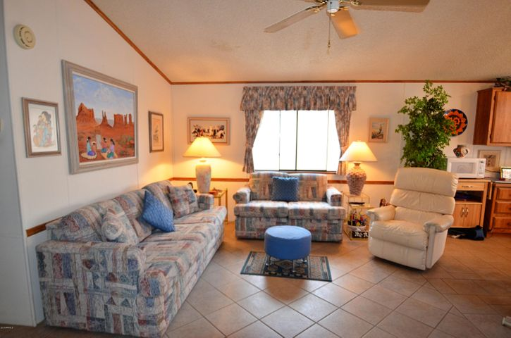 Beautiful open floor plan living room. Property has tile in all the main areas, and carpet in the bedrooms. Tastefully decorated with a Southwestern Style.