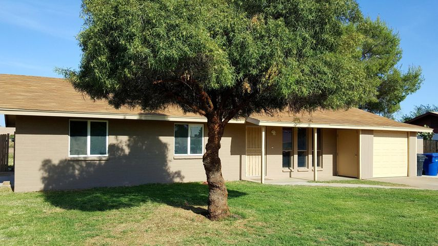 Your new home with cooling grass and large shade tree.