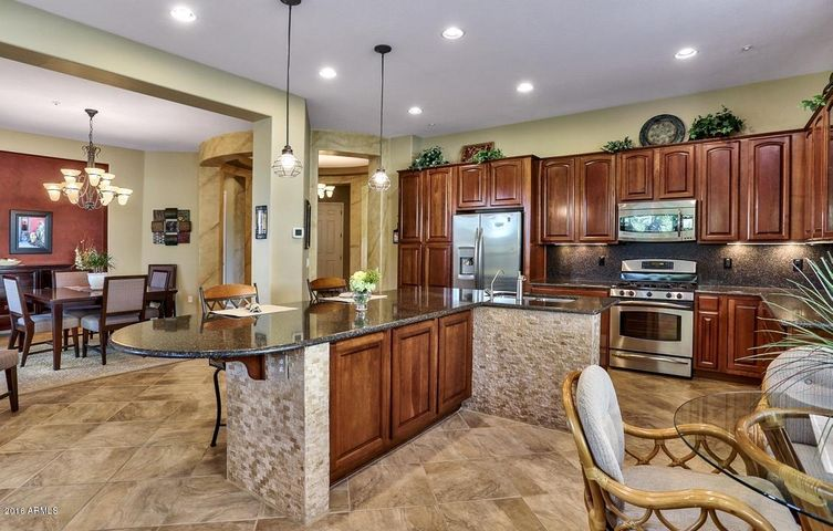 HIGHLY UPGRADED KITCHEN FEATURES CUSTOM STACKED STONE ACCENT WALLS ON KITCHEN ISLAND!