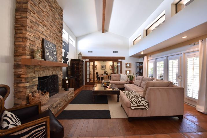 Beamed ceilings, stoned fireplace (one of three fireplaces) - office thru double doors