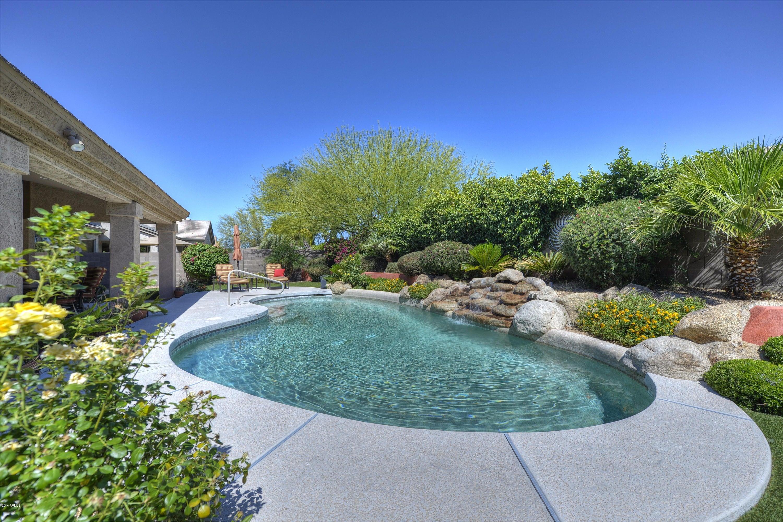 Frolic in your heated salt water Pebble tec Pool with Rock Waterfall