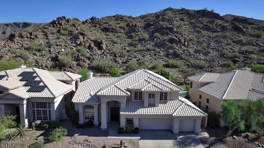 Beautiful two story home nestled at the base of the mountain preserve