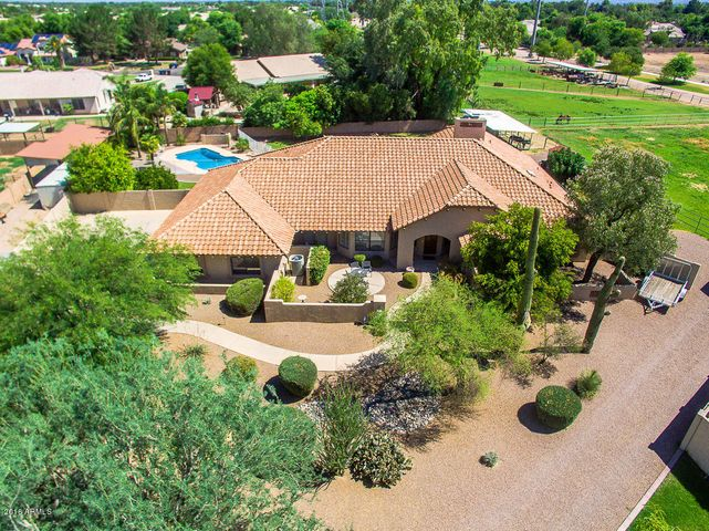 Arial view of this beautiful home on over an acre.