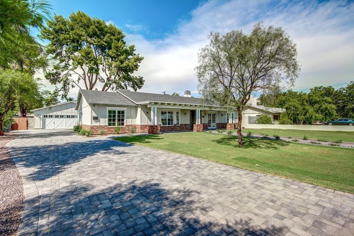 Welcome home! Beautiful pavered driveway to oversized, attached garage.
