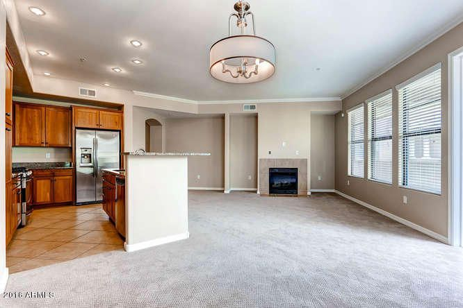Light and bright great room with gas fireplace. Open kitchen makes this condo a special place to entertain!