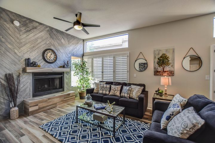 Custom herringbone pattern wood wall feature surrounding fireplace