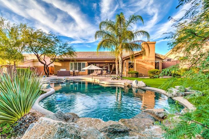Backyard oasis featuring heated pool and spa. Pool fountain