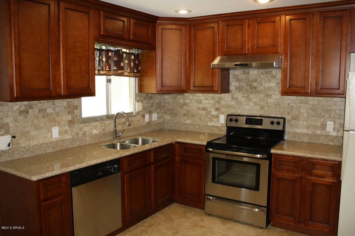 BEAUTIFUL CABINETS AND SOLID SURFACE COUNTERS