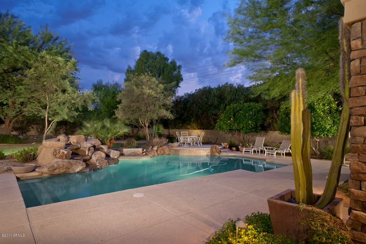Pool with Water Feature and Heated Spa