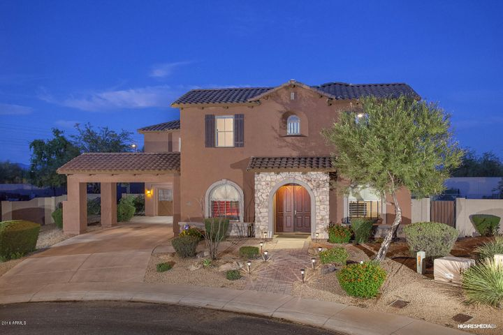 Beautiful curb appeal, professionally landscaped and lovely Porte Cochere!