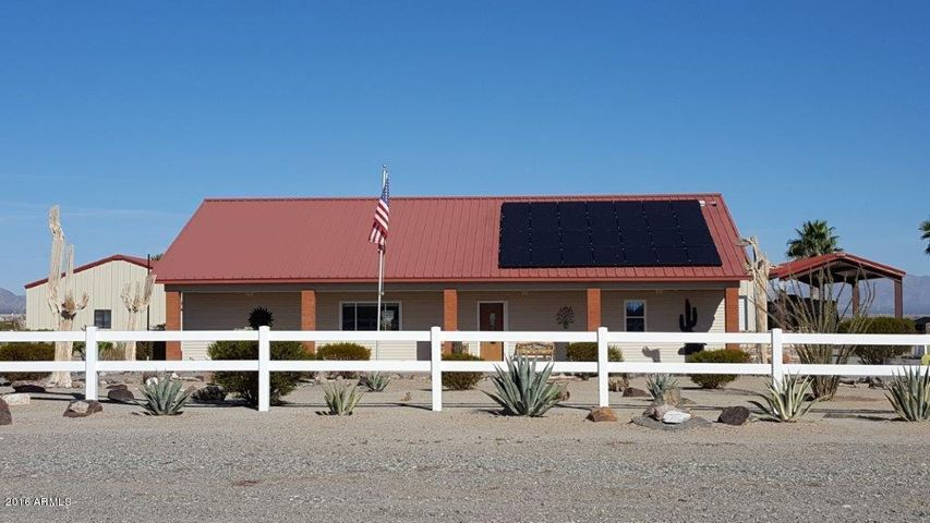 Beautiful house, shop & garage on 1 acre lot & extra lot.
