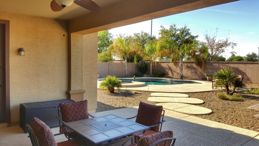 Enjoy relaxation from your patio or take a quick dip in the pool just a few feet away.