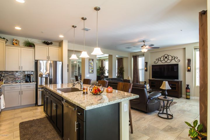 Gourmet kitchen has staggered upper cabinets with crown molding.