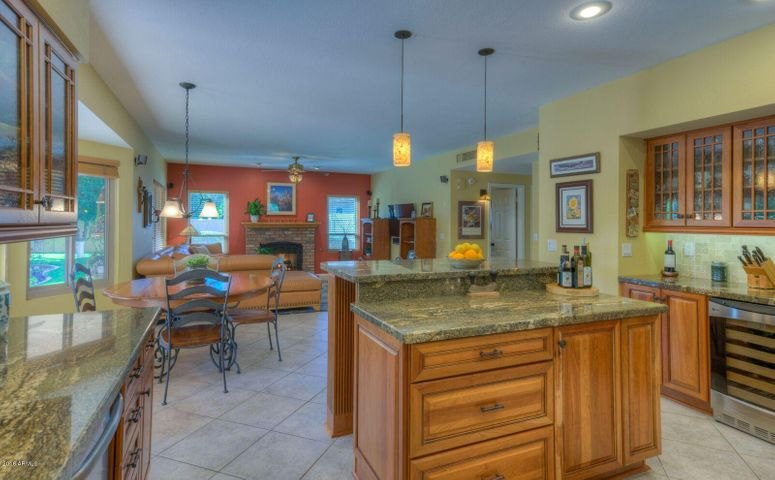 Completely remodeled kitchen opens to a fantastic family room with fireplace.