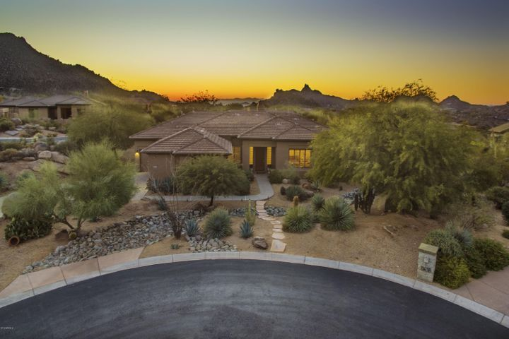 Incredible sunsets and mountain views from this spacious and comfortable home in the gated community of Desert Summit.
