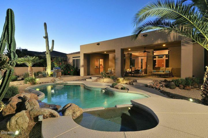 Desirable Southern Backyard with Heated Pool & Spa, Boulder Falls and Majestic Palms